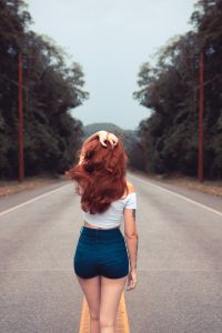 woman-standing-on-road-1758144